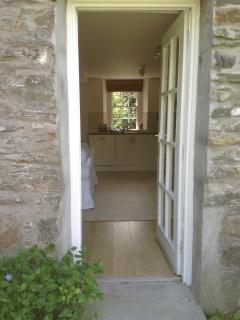 The kitchen/living area leads to the sunny enclosed walled garden. Great for al fresco dining.