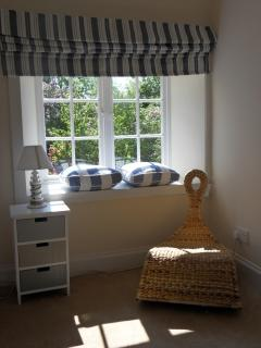 Enjoy a view over the beachcombers garden. Children and adults love the seaside themed bedroom.