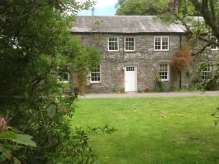 Scottish self catering holiday cottage by the sea surrounded by lovely gardens and private orchard.