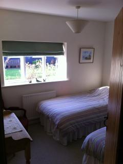 Twin bedroom with west-facing window onto garden
