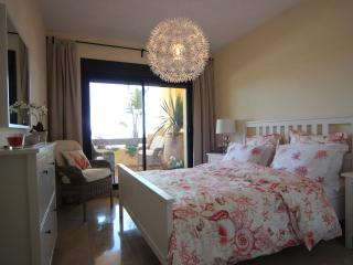 MASTER BEDROOM with comfortable bed & finest bed linens, watch the sun rise from here