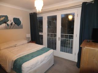Double ensuite, the other bedroom is 2 twin beds with a door leading to the garden