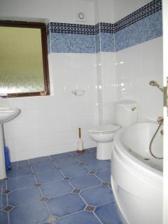 One of the four bathrooms/ensuites