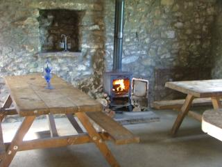 You can camp all year round in our barn with cosy woodburning stove