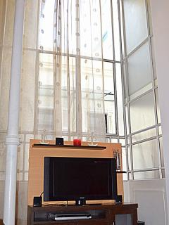 Floor to Ceiling Windows w/42' TV, DVD/CD, Surround Sound, And many English Speaking Channels
