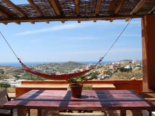 Enjoying the great sea view and the islands beyond, lying in the hammock