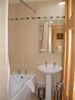 Bath, Shower and toilet beside the bedroom and fluffy white bath sheets for guests!