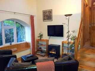 Delightful lounge with large wall mounted flat screen satellite TV and free Wi Fi