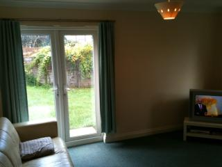 Spacious lounge with TV, DVD player, CD player & Wi-Fi leading into garden