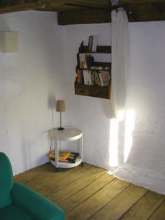 Upstairs sitting room - bookcase and games