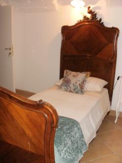 One of the antique beds in the twin room.