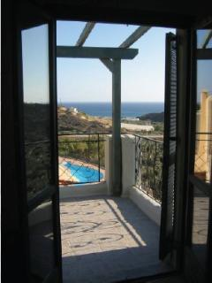 Fabulous view of the pool, Makrigialos and sea beyond from the first floor master bedroom