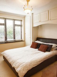 Double bedroom, plenty of cupboard space, overlooking your private garden.