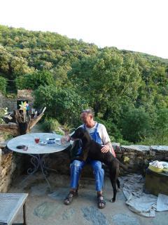 My dear neighbor and my faithless hound, sharing aperos on my terrace.