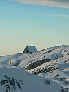 Mountain hut in winter time