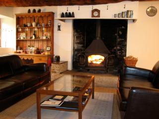 Two comfortable sofas and a wood burning stove, great for chilly evenings off-season.