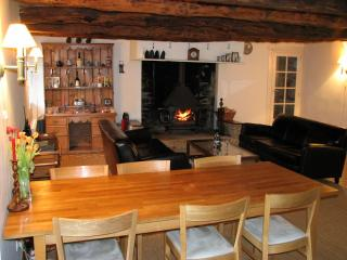 Spacious lounge/dinning room with traditional wood beamed ceiling.