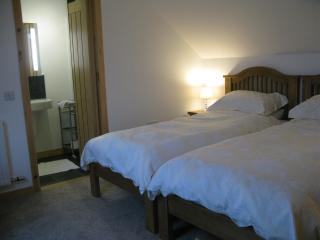 Twin bedroom and en suite shower room.
