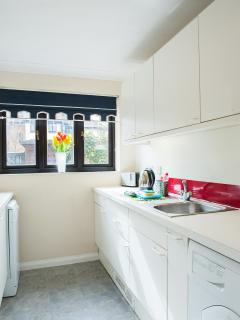 Sunny kitchen over looking your enclosed private patio garden, ceramic hob,oven,dishwasher, fridge,