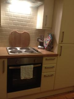 The kitchen has an oven, electric hob and lots of kitchen gadgets