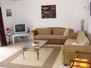Spacious living room with flat screen TV which receives over 200 channels  in English and free WiFi