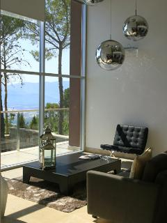 Large windows fill the rooms with light and open up the views