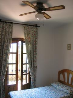 Twin bedroom also has ceiling fan