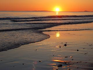SUNSET ON TYWYN BEACH OPPOSITE