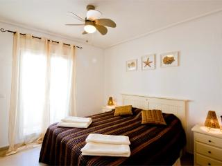 Luxury bedroom, your choice of king or single beds with fitted wardrobes and doors to terrace
