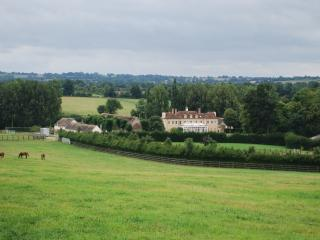 Haras du Gazon nestled in a green valley in the lush Normandy countryside