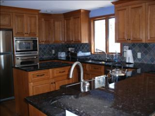 The Kitchen is gorgeous with granite counters and  hardwood floors.