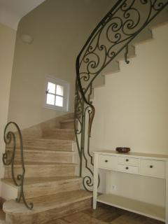 marble staircase to bedrooms