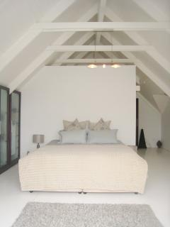 Spacious Master bedroom, with King extra length bed, large balcony and beautiful views and sunsets
