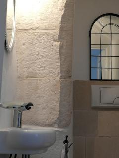 The bathroom is functional and comfortable, modern while keeping original architectural details