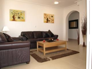 Light and airy lounge with leather sofas and 32 inch flat screen TV