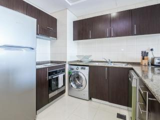 Fully-equipped kitchen with f/freezer, cooker, microwave, dishwasher and washing machine.