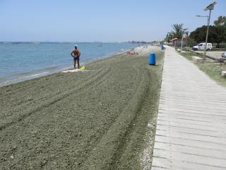 Walk Away From Beach, Bars, Bustop And Restaurants