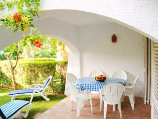 Covered terrace for relaxing & dining. Garden is illuminated at night.