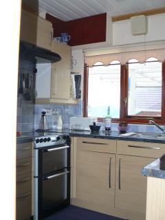 Kitchen has river views