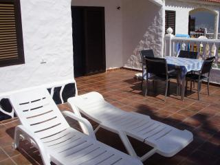 Sun Loungers and outside dining table, leads out to the five pools on the complex