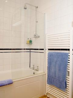 Bathroom With bath and shower over and Molton Brown Products