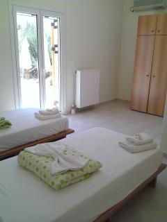 Twin bedroom with double patio doors and en-suite