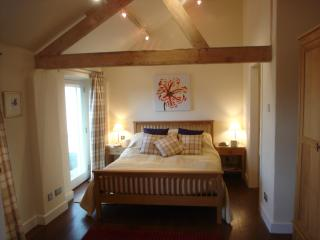 king size bed in a lovely light room