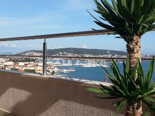 Welcome to The CroSun apartments- view from terrace to local harbour, Seget village and Trogir town