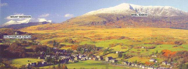 Dolwyddelan village at the foot of Moel Siabod and Snowdon in the background.
