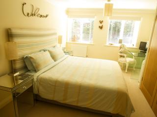 Large en suite master bedroom with 6' wide superking size bed and its own TV/DVD player