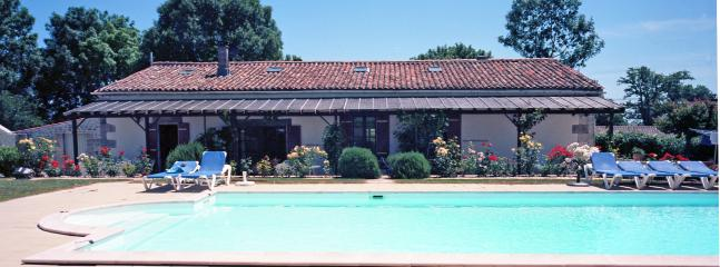 Heated Pool and Gardens.  There is an electric cover for safety.  Kept very clean by the owners.