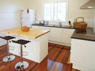 Country style kitchen with original timber floors. Everything you need in this well appointed room.