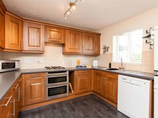 The well equipped kitchen with double oven, microwave and full height fridge freezer