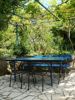 Another terrace with dining table, in the garden